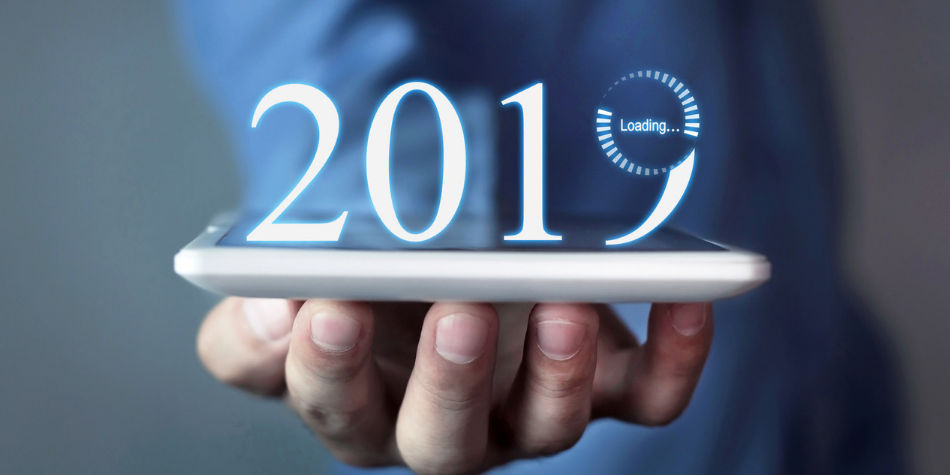 Man holding tablet with 2019 on it